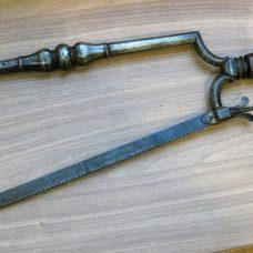 A wrough iron amputation saw, late 17th century