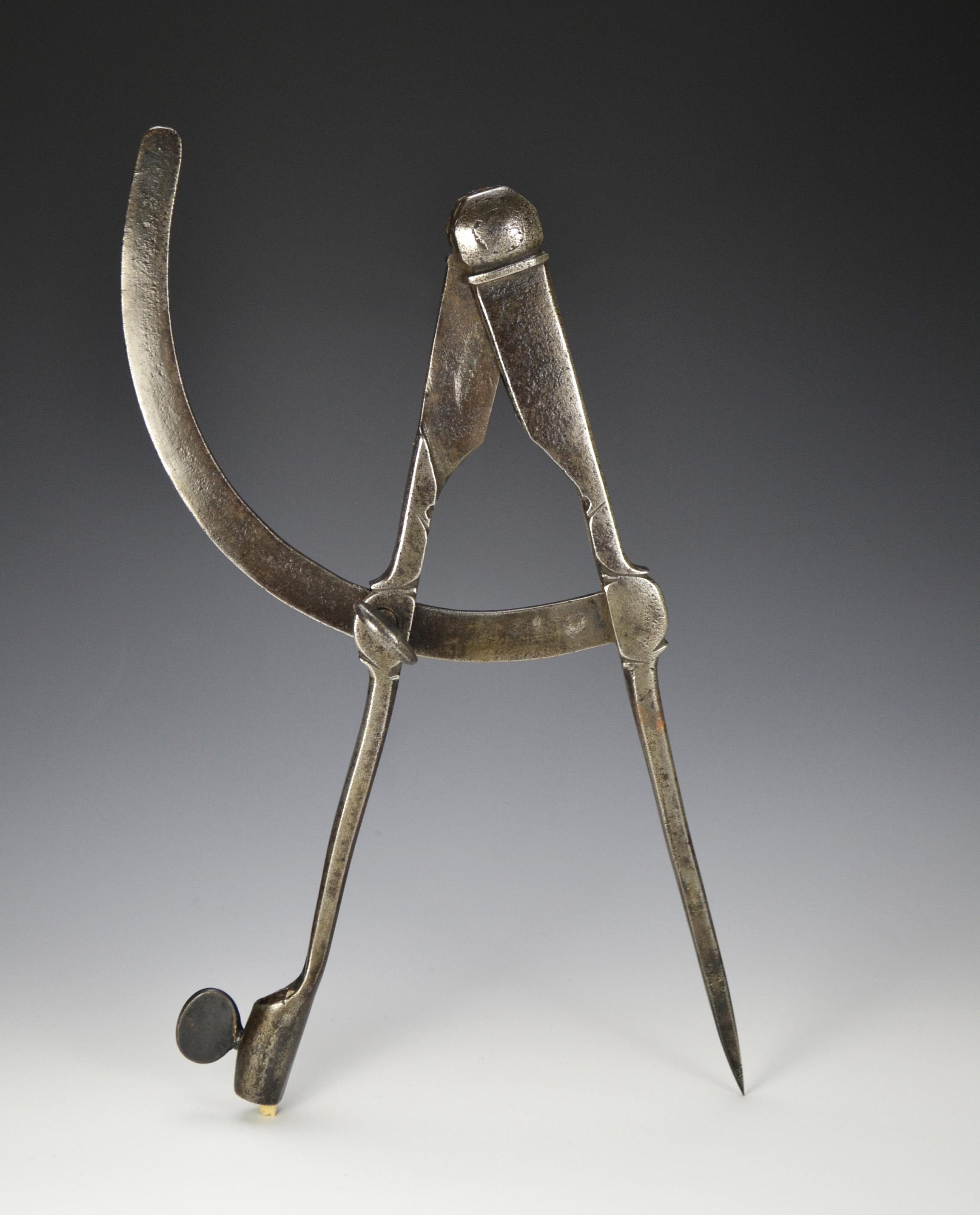Decorative 18th century iron wing compass