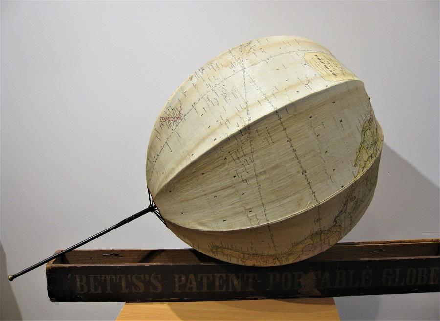 A pristine Bett's portable folding terrestrial globe in its original case, circa 1860s'