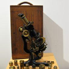A Watson binocular polarizing microscope, number 40854, circa 1920
