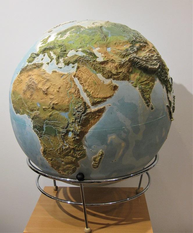 A large 50cm diameter plaster relief terretrial globe 1950s'