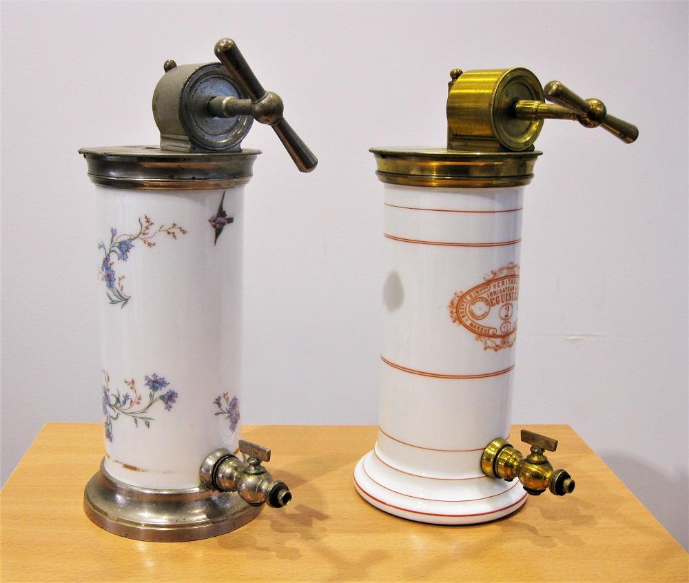 Two fine porcelain Eguisier vaginal enema/douche pumps, 19th century
