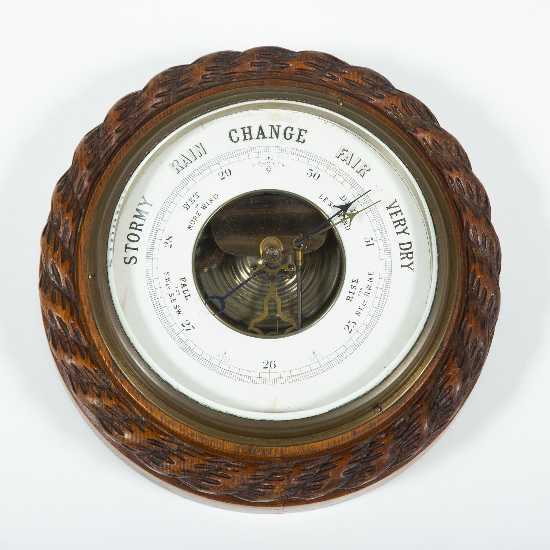 Oak cased aneriod barometer 6 inch dial.