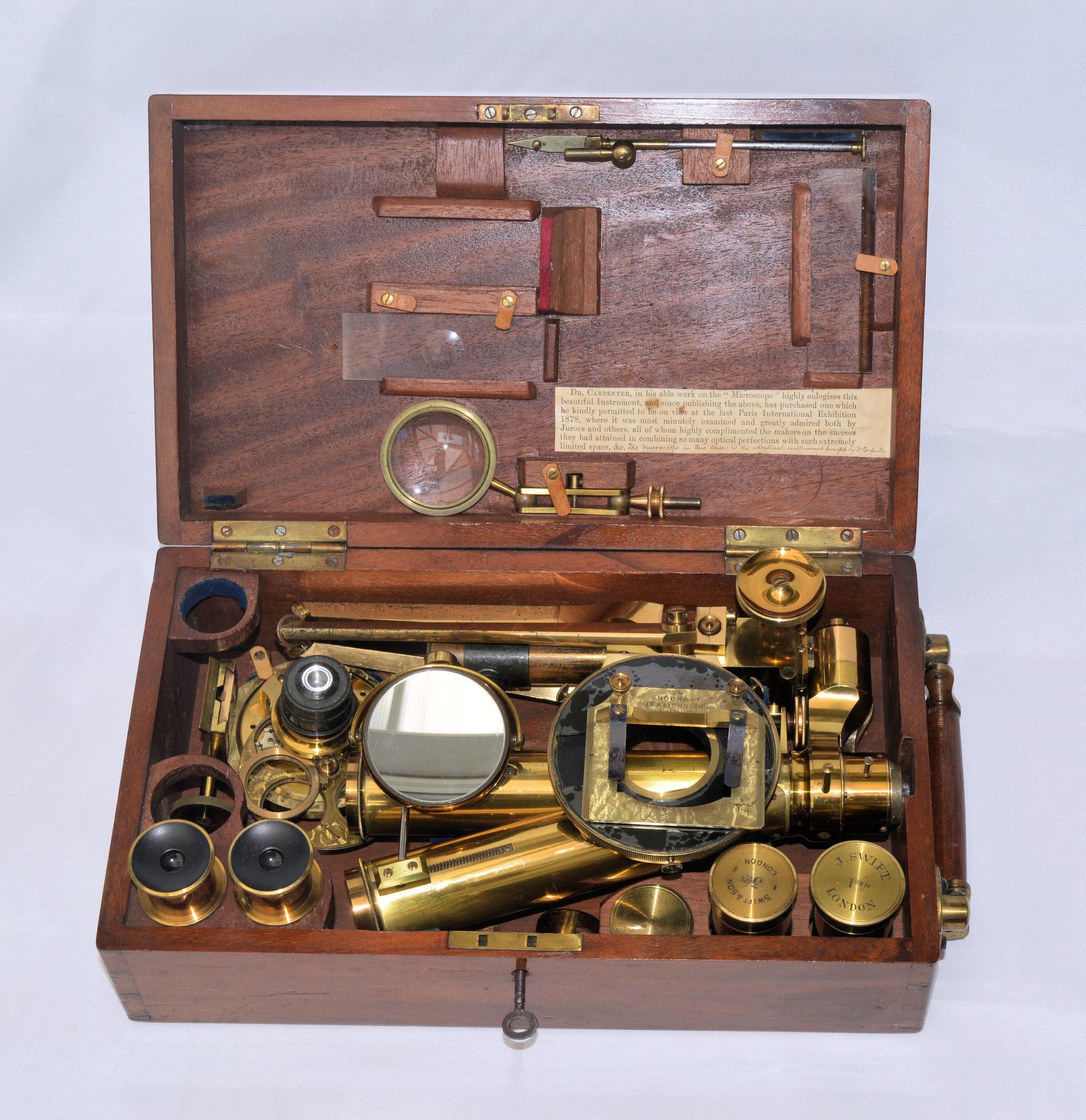 SOLD – A rare Swift folding portable microscope in case.