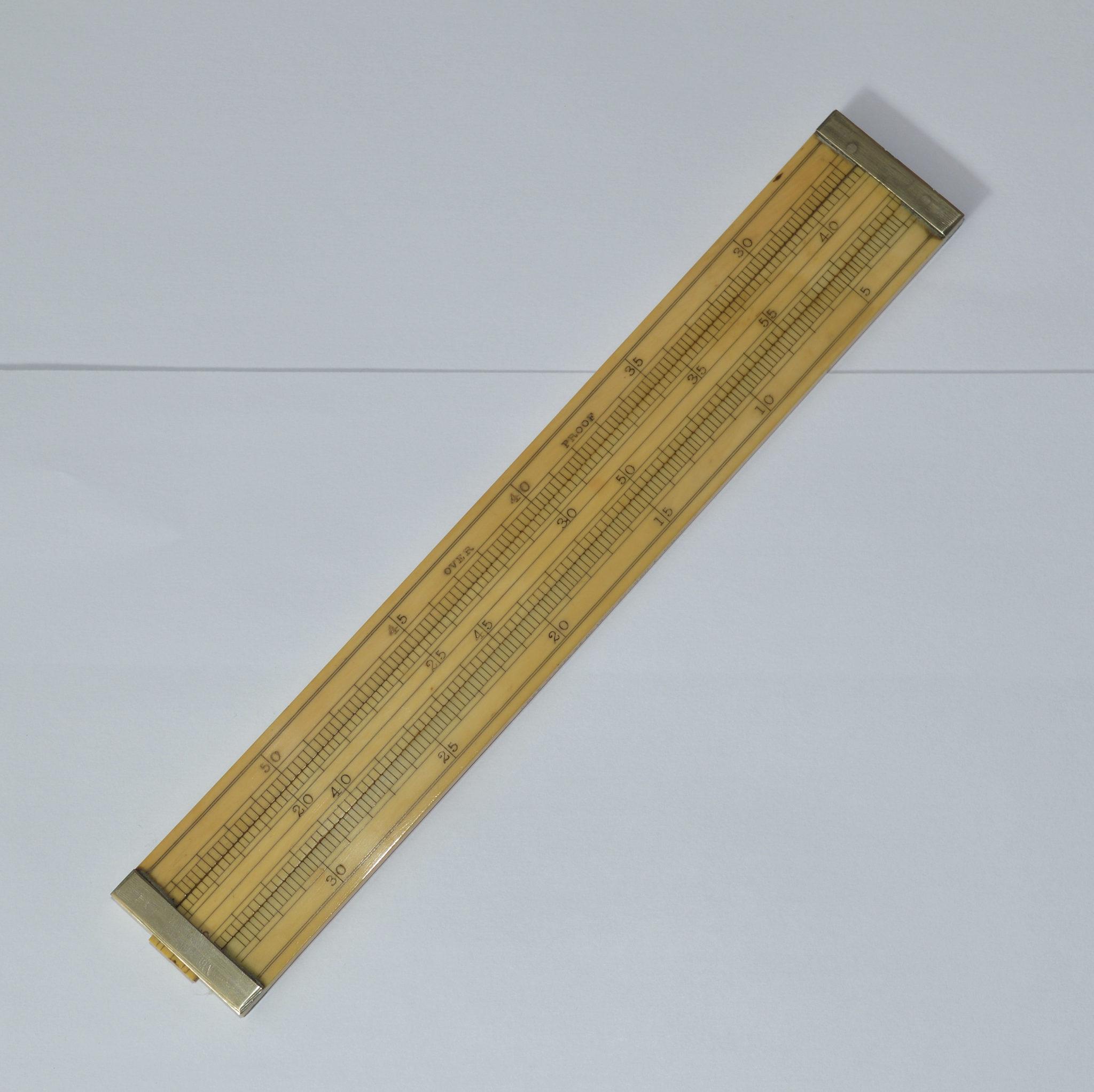 9 inch ivory slide rule – Buss, Maker, 33 Hatton Garden, London.