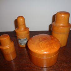 3 Boxwood bottle holders and 1 boxwood receptacl