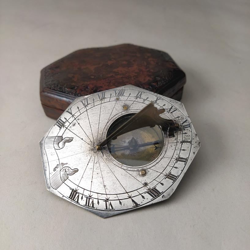 A monolatitudinal silver Butterfield-dial with case.