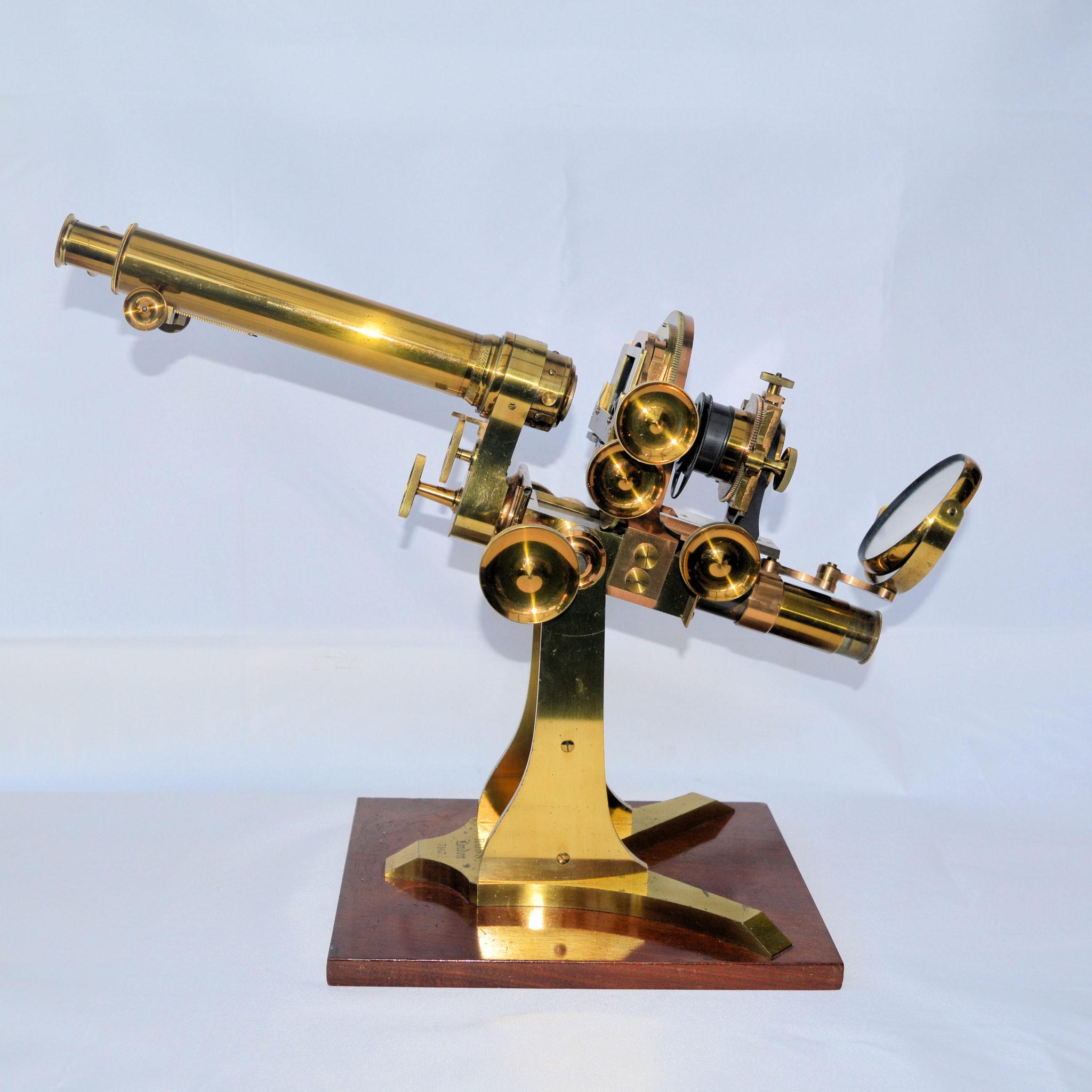 A large Wenham binocular microscope by Ross.