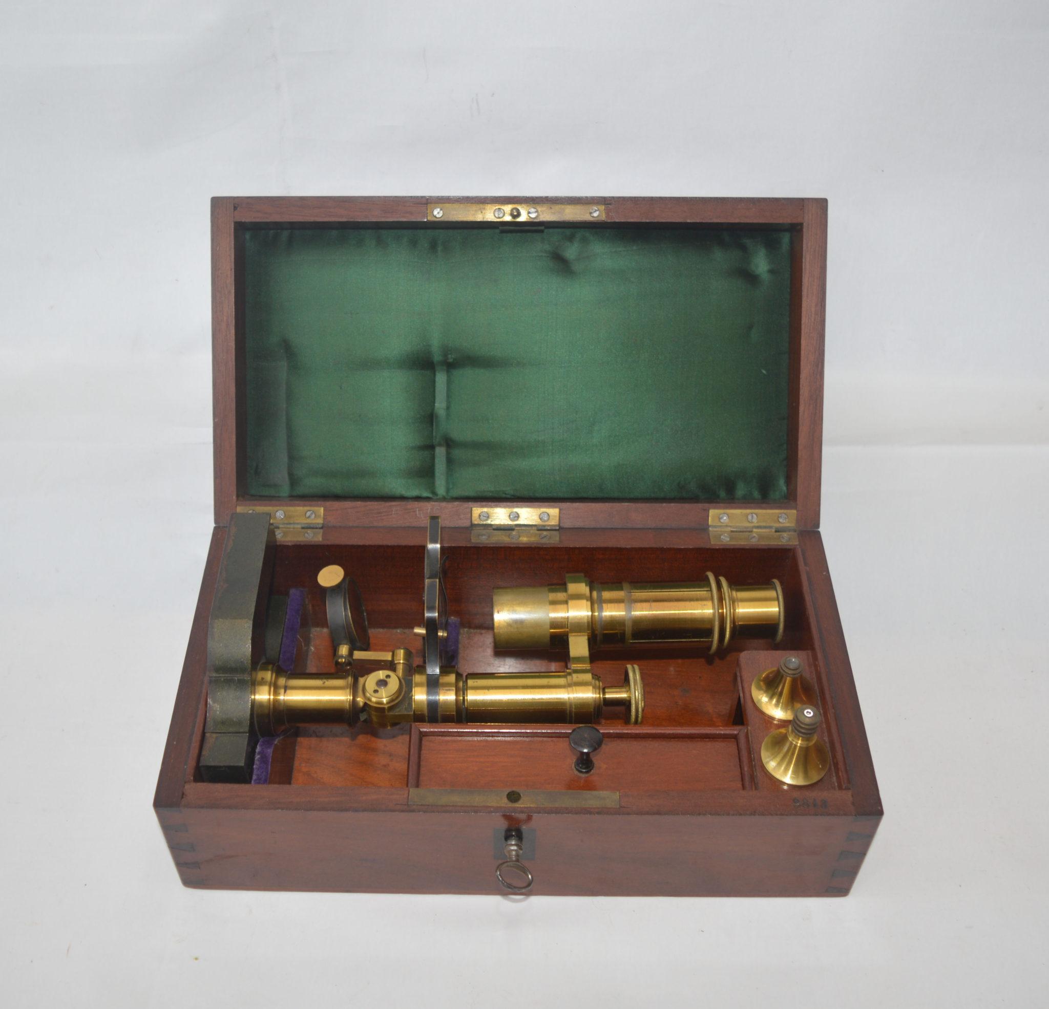 SOLD – Microscope by Hartnack in mahogany case.